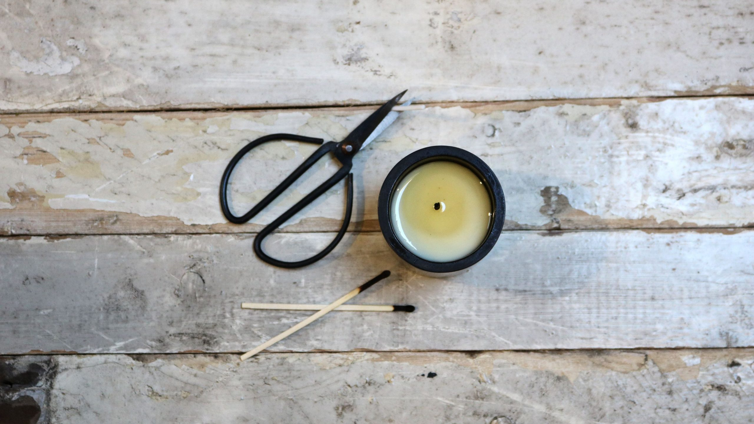 Candle care image, wick cutter, matches, blown out candle