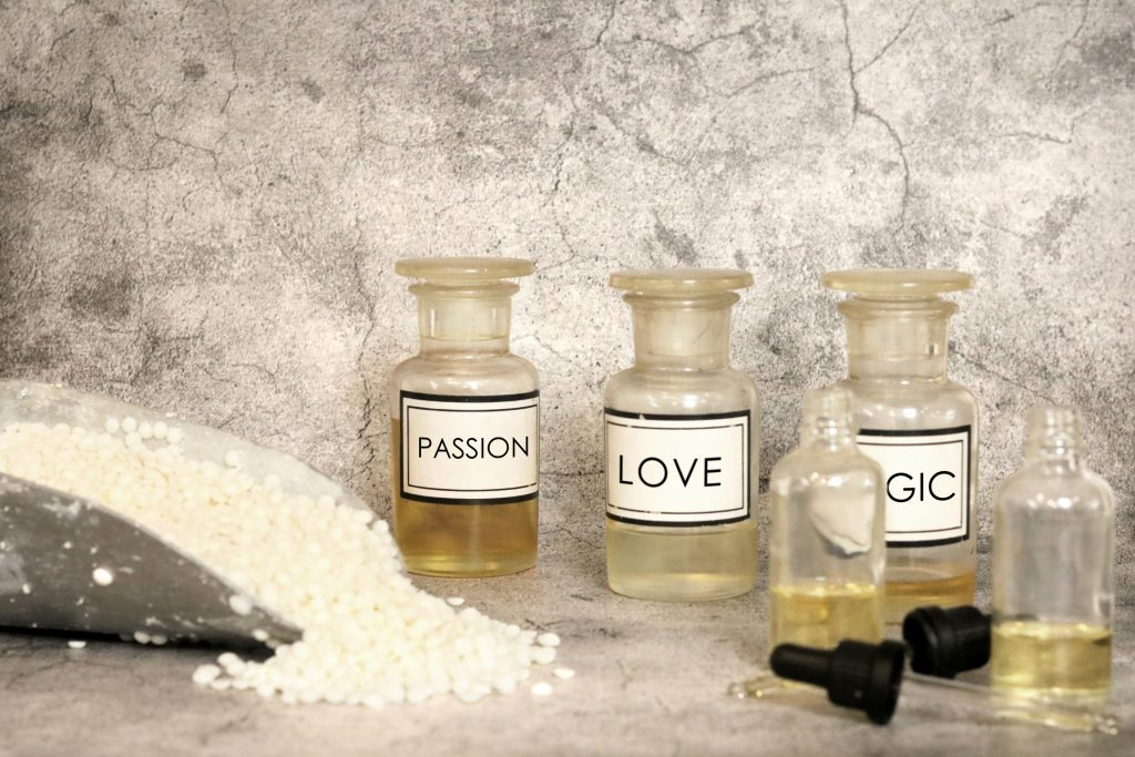 our process image. mixture of scents in chemistry bottles